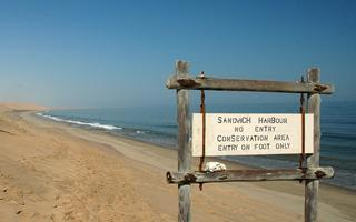 Sandwich Harbour at the Namibian coast - Where dunes and ocean meet